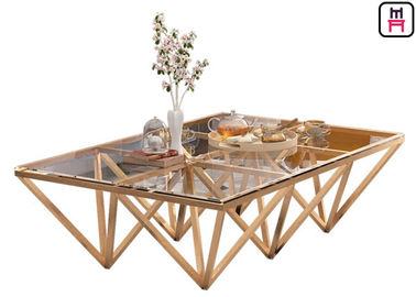 China Indoor Tempered Glass Top Stainless Steel Coffee Table With Triangle Geometrical Base factory